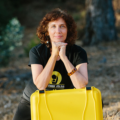 Decorative hero image for Laura Stachel: Innovative obstetrician who reduces maternal and newborn mortality by illuminating delivery rooms around the world through distribution of Solar Suitcases page.
